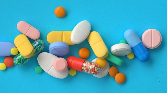Imagem De Vários Medicamentos Orais Espalhados Em Uma Superfície